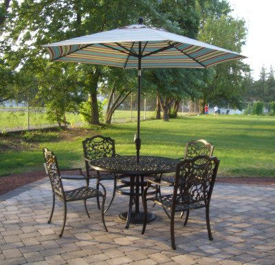 paver patio with wrought-iron table and chairs
