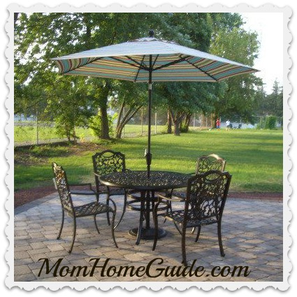 paver patio, wrought iron table, chairs, chain link fence, privacy
