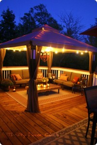 beautiful outdoor deck with lighted gazebo