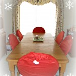 farmhouse table, kitchen, oiled bronze chandelier, santa hat chair covers