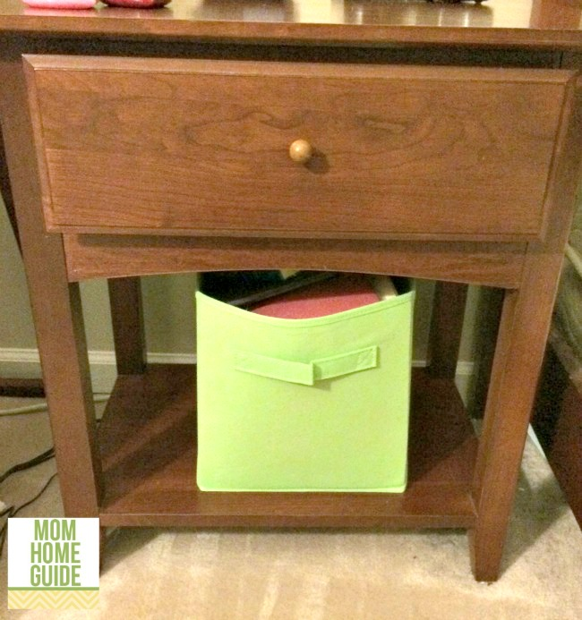 nightstand with fabric organizing bin for magazines and books