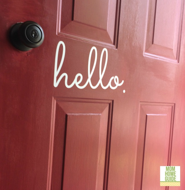 A red front door with Modern Masters Door Paint and a hello door decal by The Vinyl Company