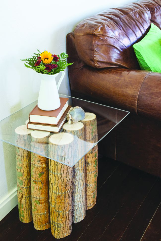 a side table can be made out of tree branches with a glass or plexiglass top