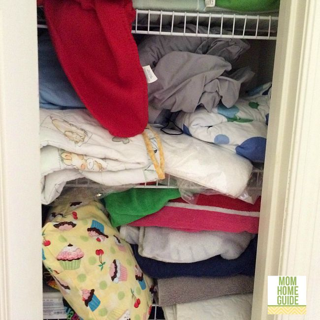messy and disorganized linen closet