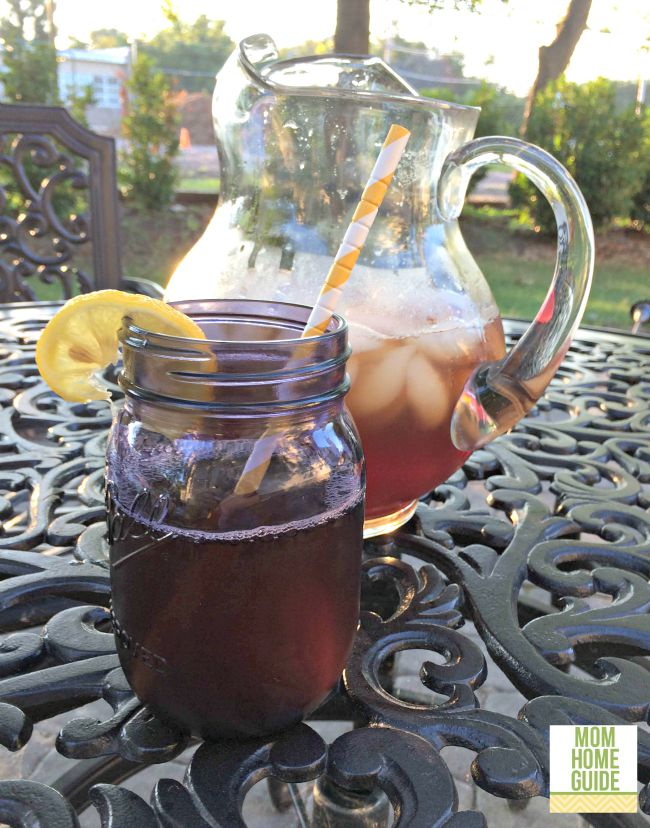 Sweet tea with lemon in a mason jar with a paper straw