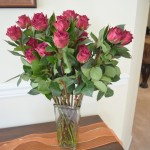 I love the way this vase of red roses looks on my DIY chalk painted and stained console table!