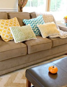 A bright and sunny living room decorated for fall
