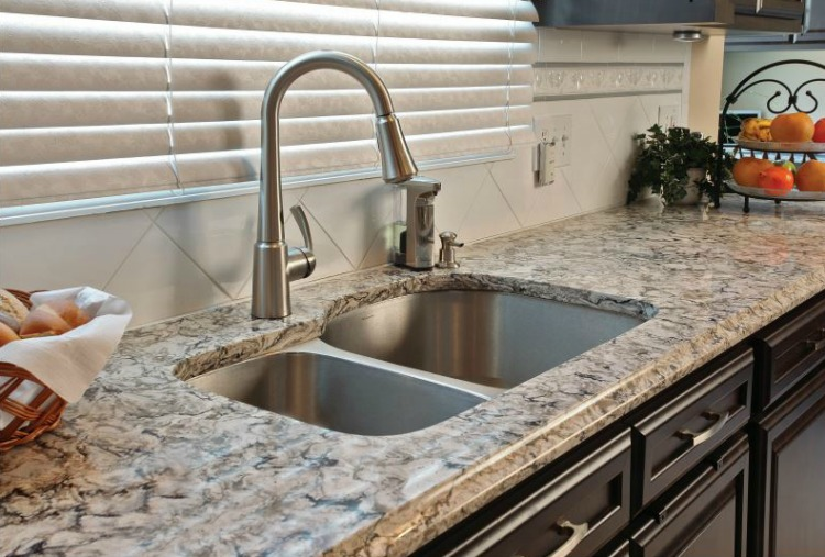 I love the undermount stainless steel sink in this remodeled kitchen by Kitchen Magic!