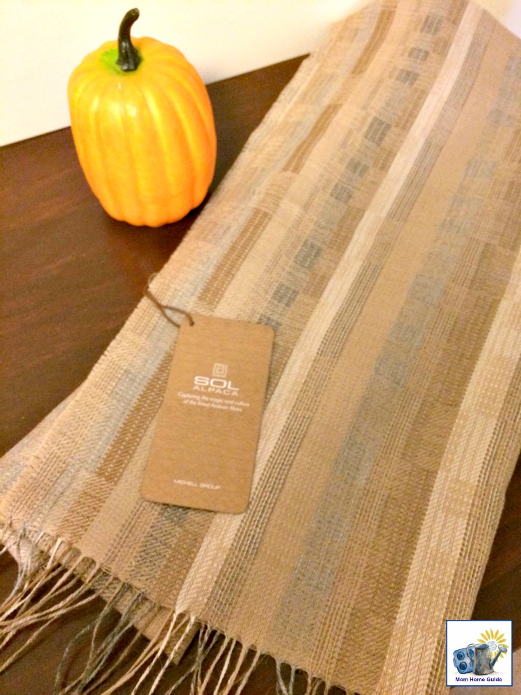 A silky Sol Alpaca scarf also makes a great table runner