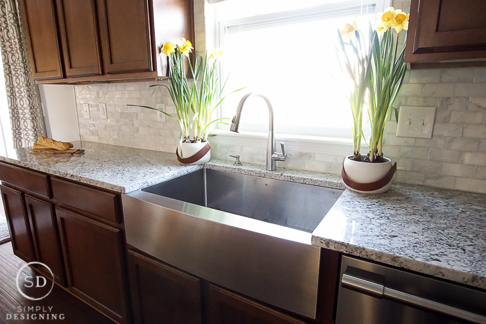 Beautiful kitchen remodel with marble backsplash, granite counters, and new appliances from Frigidaire and Lowe's