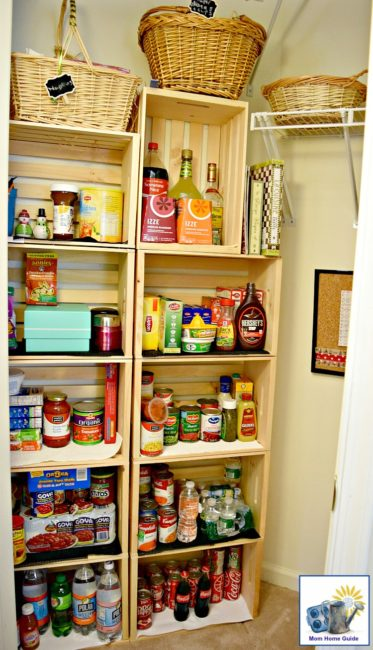 Easily convert a coat closet into a cute pantry by screwing some inexpensive wooden crates together