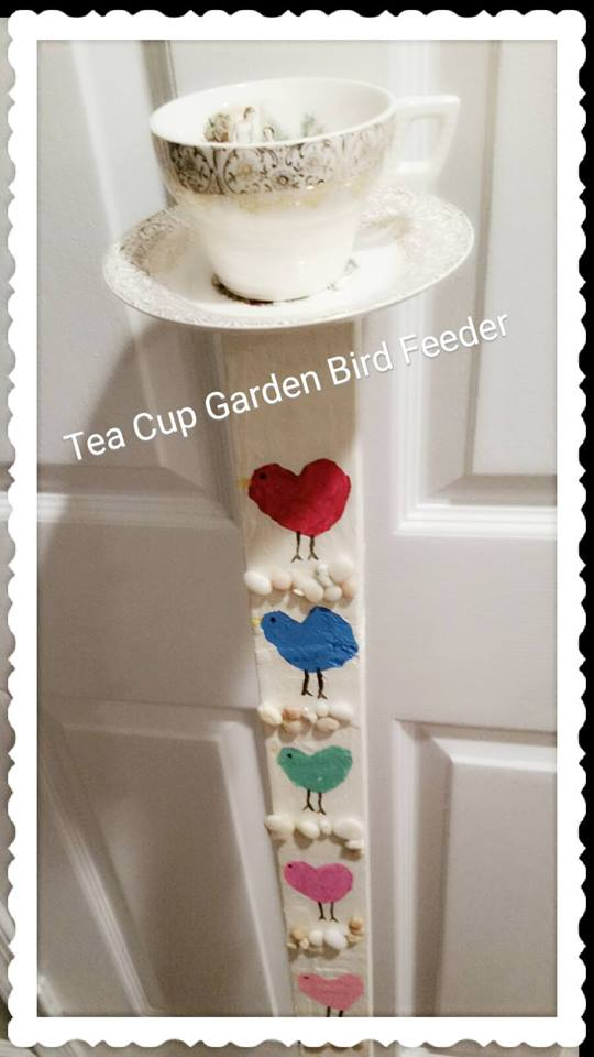 Tea cup garden bird feeder -- I need to make one of these!