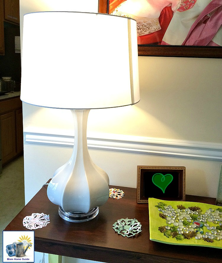 white gourd lamp on chalk painted console table in living room