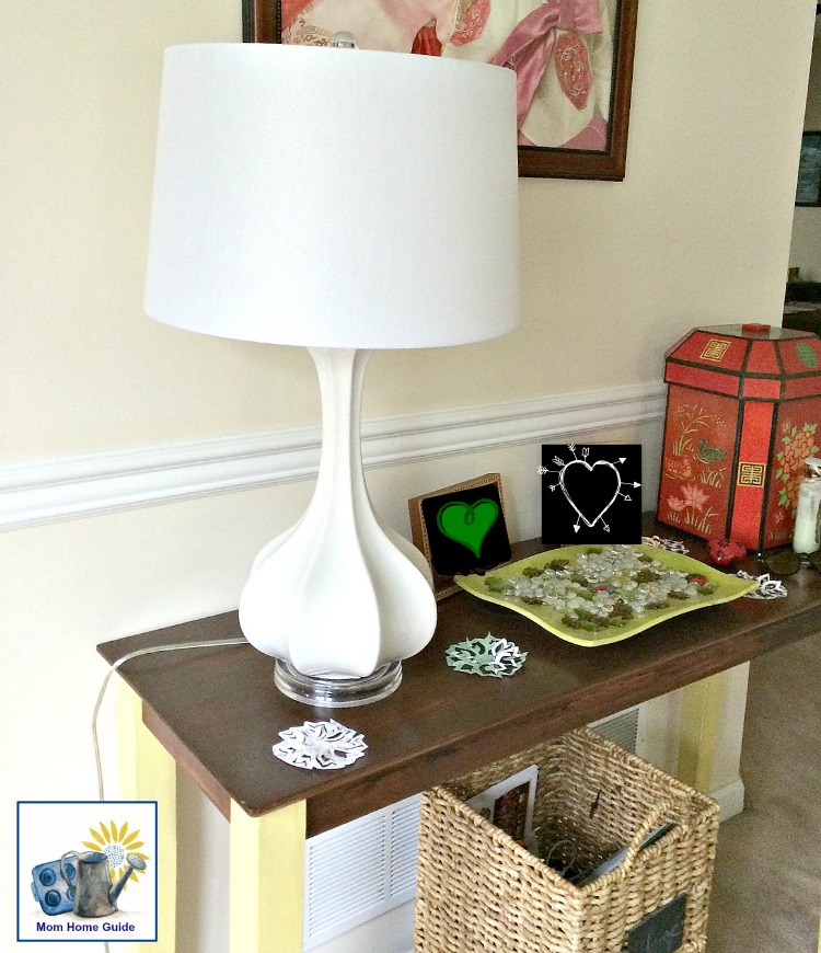 white ceramic gourd lamp on a chalk painted console table