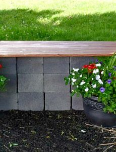 DIY Garden seating area with a wood and cinder block bench and container gardens