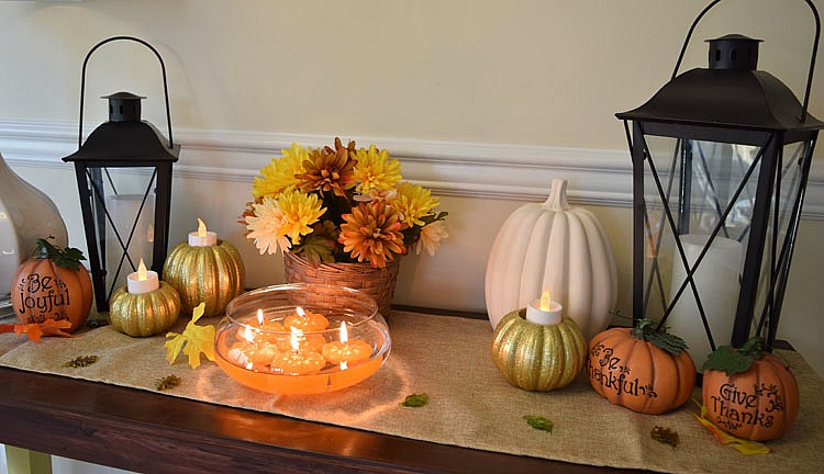 Thanksgiving console table with floating pumpkin candles