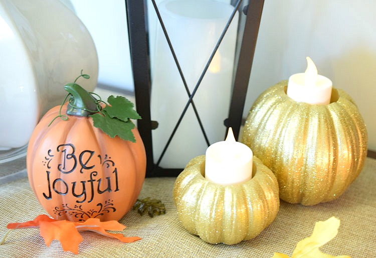 Gold glitter pumpkins on a console table