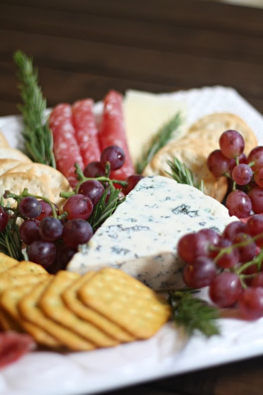 meat and cheese platter with grapes