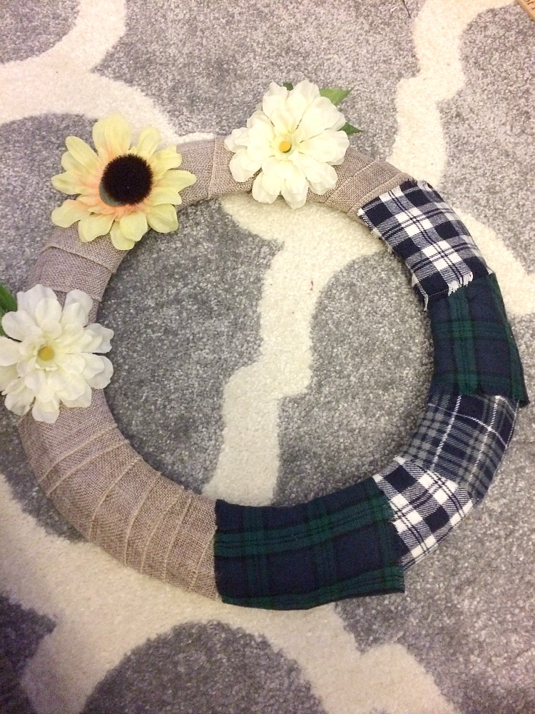 Pin strips of fabric to a burlap wrapped metal wreath form to create an inexpensive and beautiful winter wreath