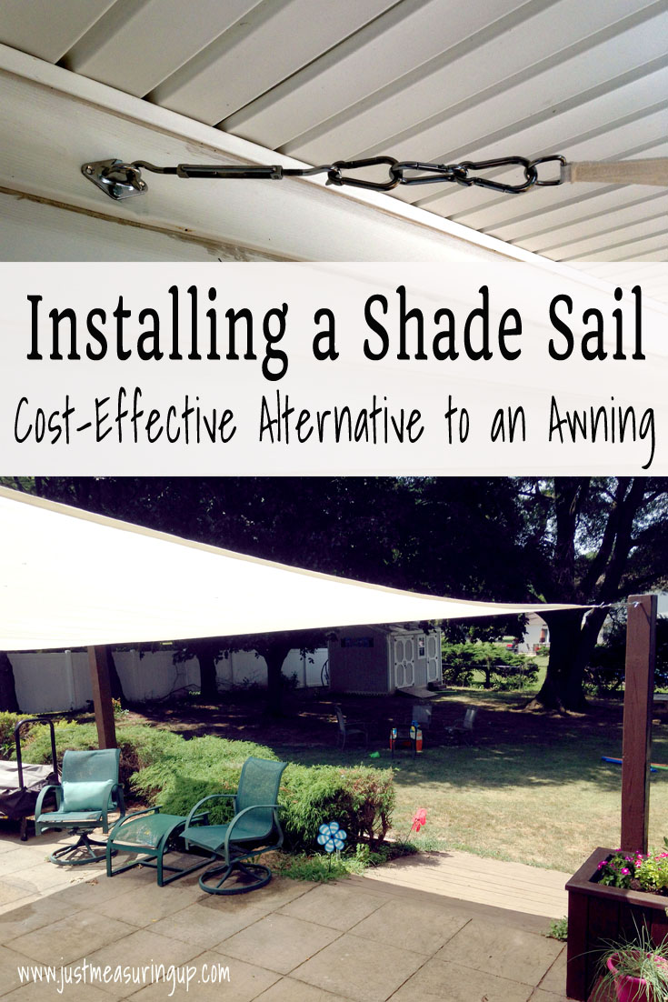installing a shade sail on the patio