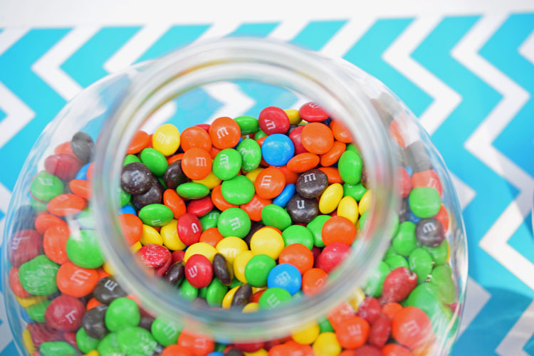 Candy-filled glass canister for teen birthday party