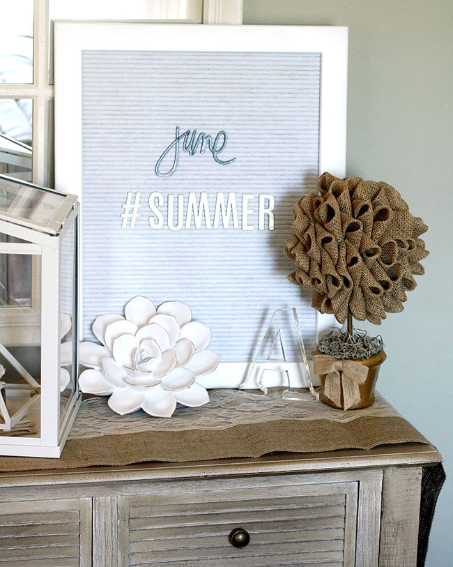 summer console table with letter board and DIY burlap topiaries