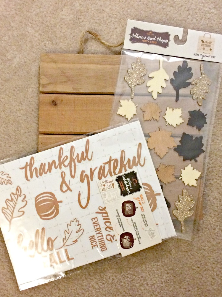 Supplies for an easy DIY pallet-style wood sign from Target's dollar spot