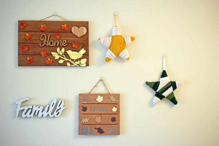 Fall gallery wall with DIY wooden signs and yarn wrapped stars