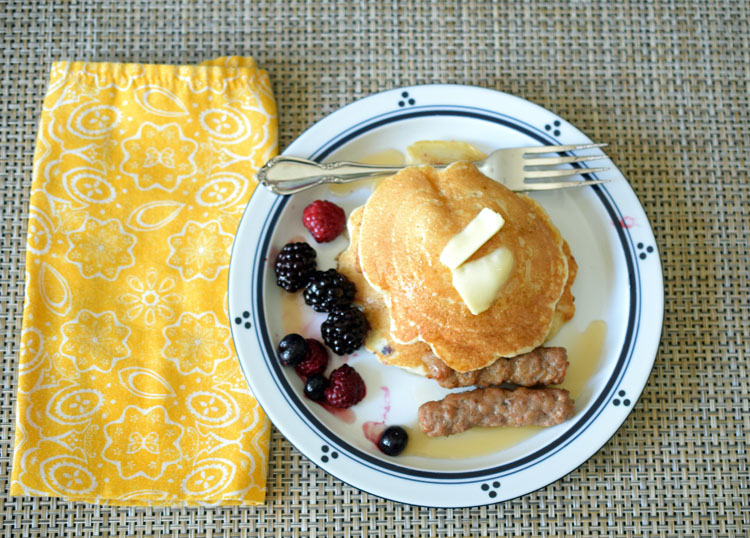 Krusteaz buttermilk pancakes with fruit and sausage