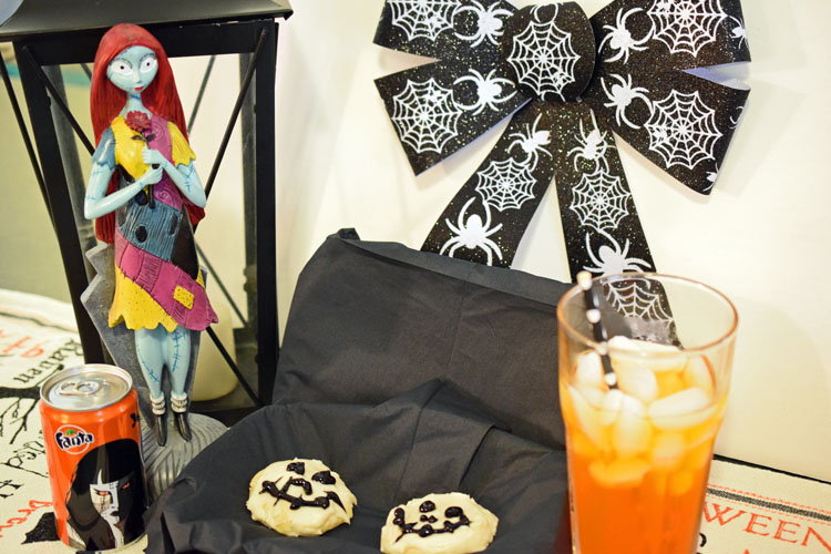 Halloween party spread with Jack Skellington sugar cookies with Fanta soda and Halloween decorations