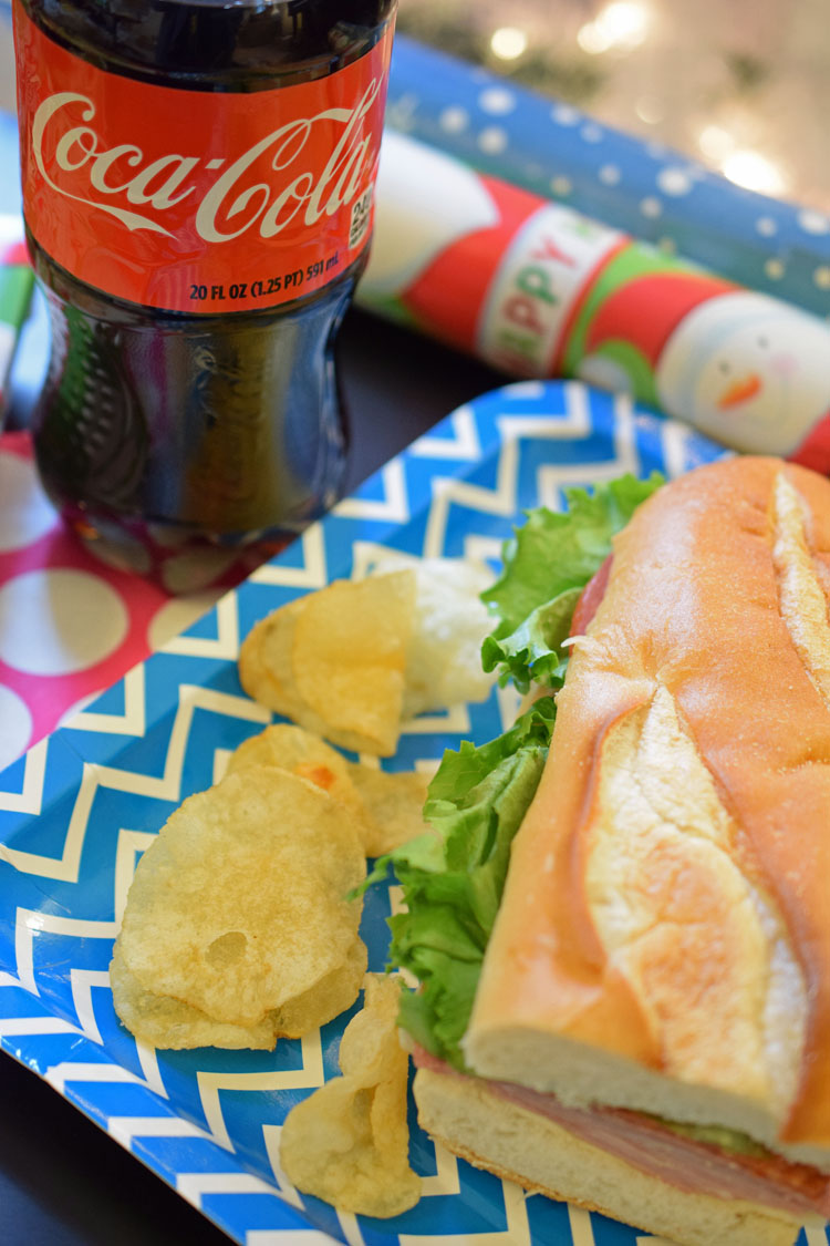 a gift wrapping party with a deli meal combo with a Coca-Cola from Stop & Shop
