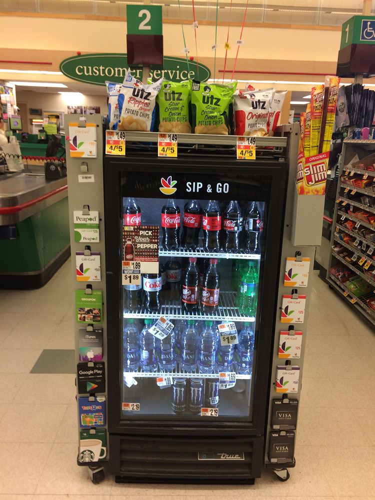 A fridge of cold Coca-Colas to go at Stop & Shop
