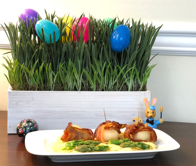 An Easter grass and Easter egg centerpiece, and a delicious Easter appetizer -- fresh scallops wrapped in bacon