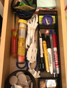 an organized kitchen junk drawer