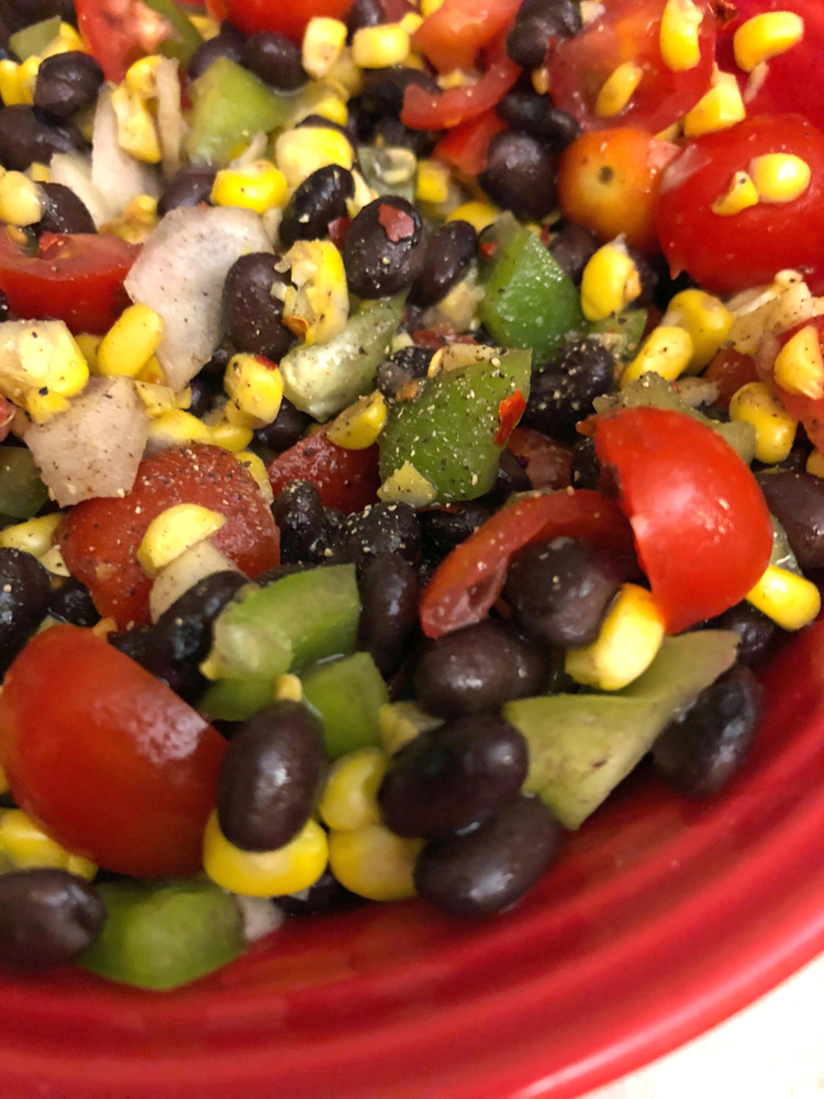 A recipe for black bean salsa made with beans, green peppers, tomatoes and onion.