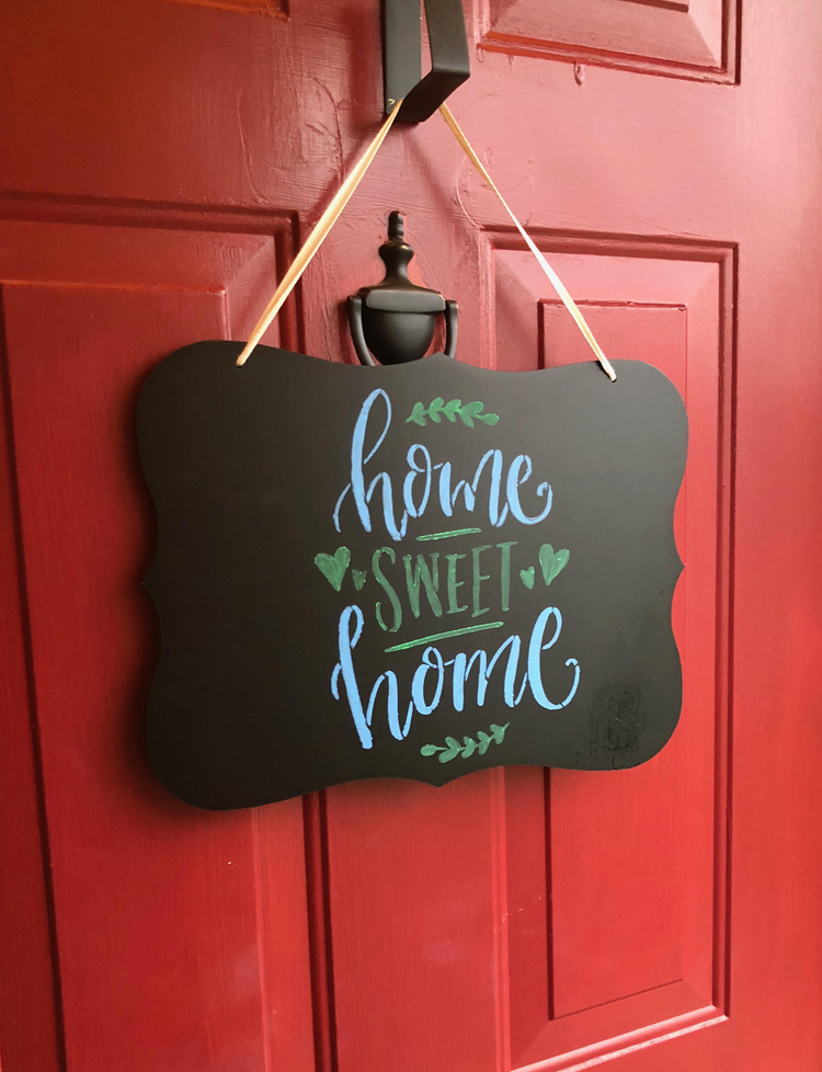 This home sweet home door decor can be made easily with an inexpensive hanging chalkboard, a stencil and some liquid chalk markers