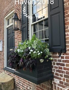 Brick home in Charleston, S.C., with a gas light