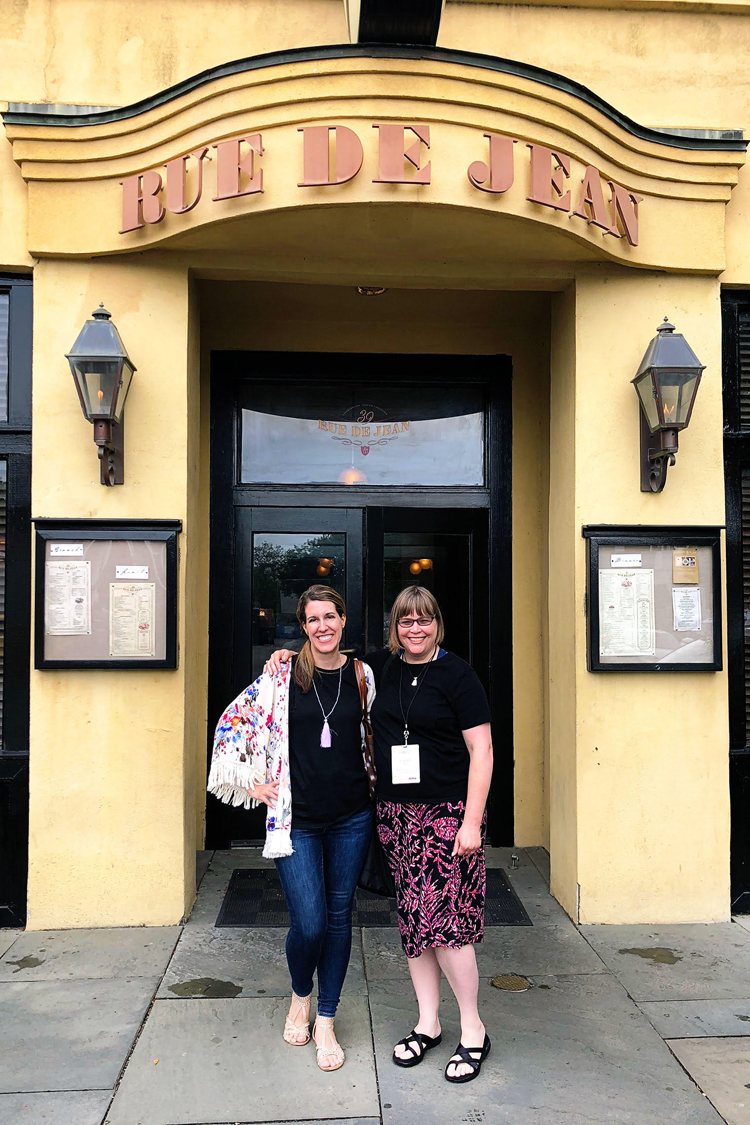 Lauren of Mom Home Guide and Carrie of Curly Crafty Mom in front of French restaurant 39 Rue de Jean in Charleston, S.C.