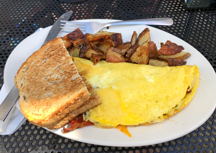 cooked ice cream parlor omelette and breakfast potatoes