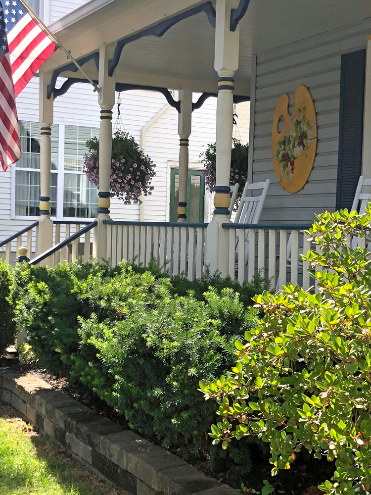 front porch on an adorable home in hammondsport, new york