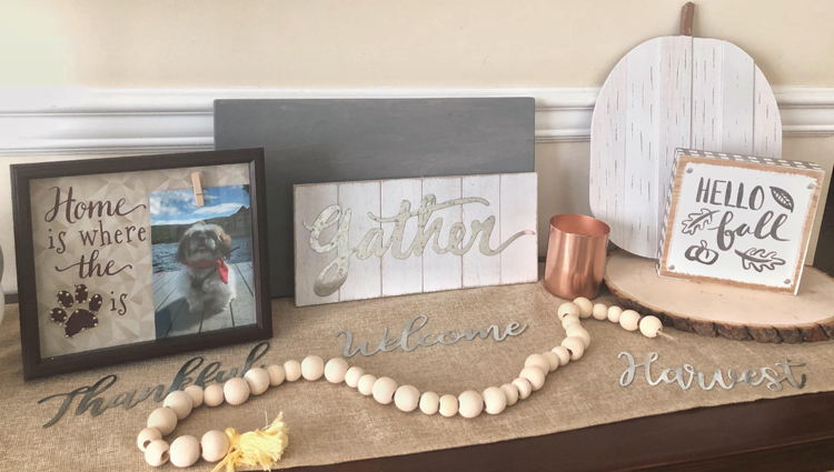 fall console table with metal welcome sign, wood beads, gather sign and wooden pumpkin