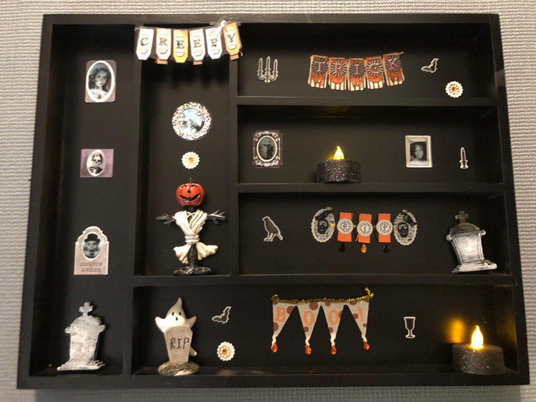 I love this easy DIY Halloween display case for displaying cute holiday miniatures.