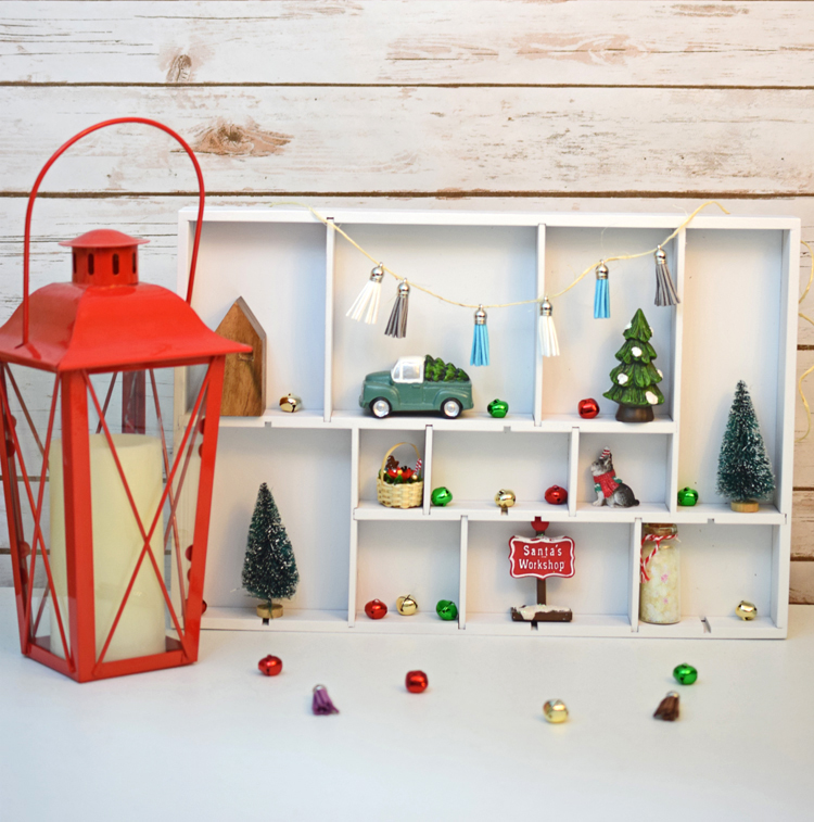 A cute DIY Christmas shadow and curio box made from a simple drawer organizer.
