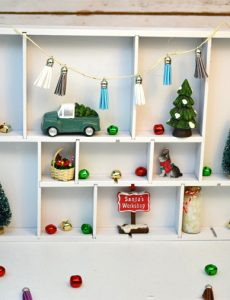 I love how my spray painted drawer organizer turned Christmas shadow and curio box turned out! It gives me a fun place to display lots of fun Christmas miniature figurines. There are so many cute ones at the craft store.