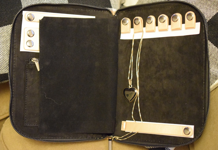 The H Halston Jewelry portfolio is perfect for keeping necklaces, etc., untangled and organized while traveling