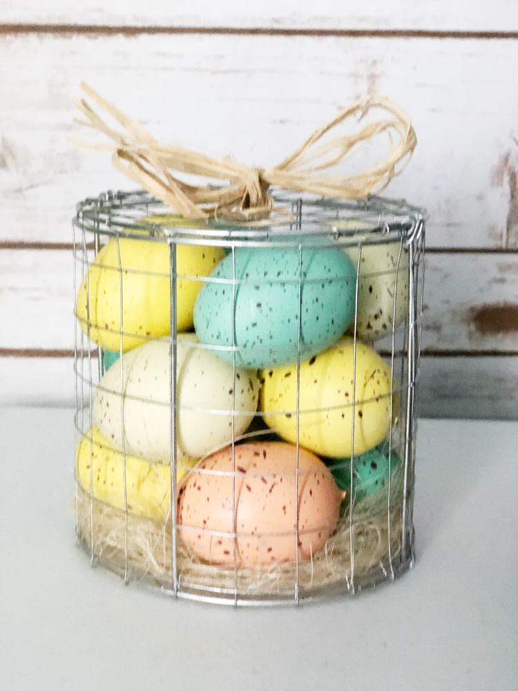 Pastel speckled Easter eggs in a wire basket