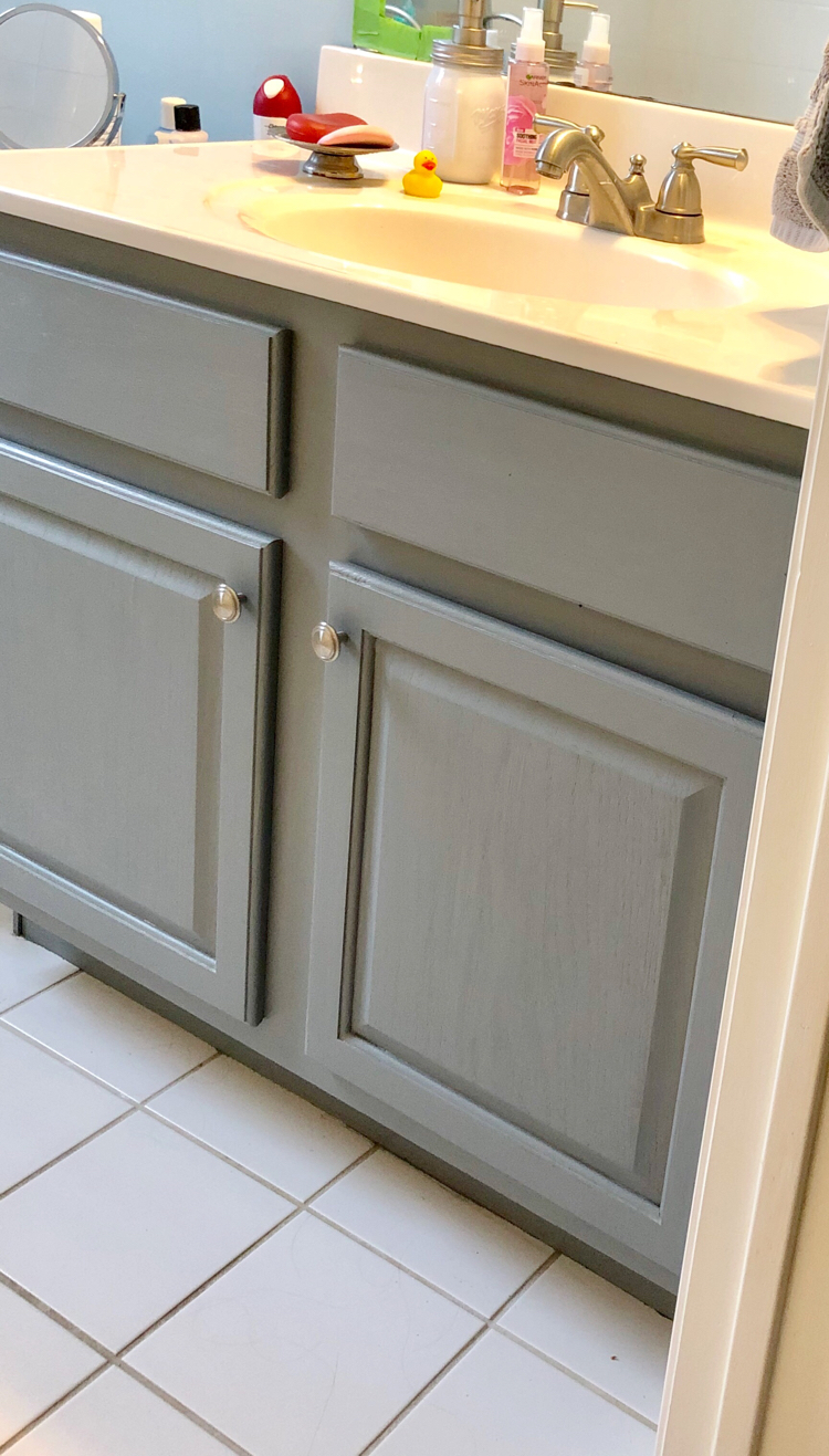 Satin Enamels paint by Americana Decor is a durable and easy way to paint a bathroom cabinet.