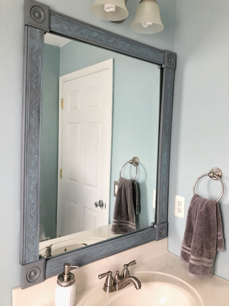 I love this easy tutorial for framing a bathroom mirror (with clips) with molding and painting it with DecoArt Satin Enamels Paint