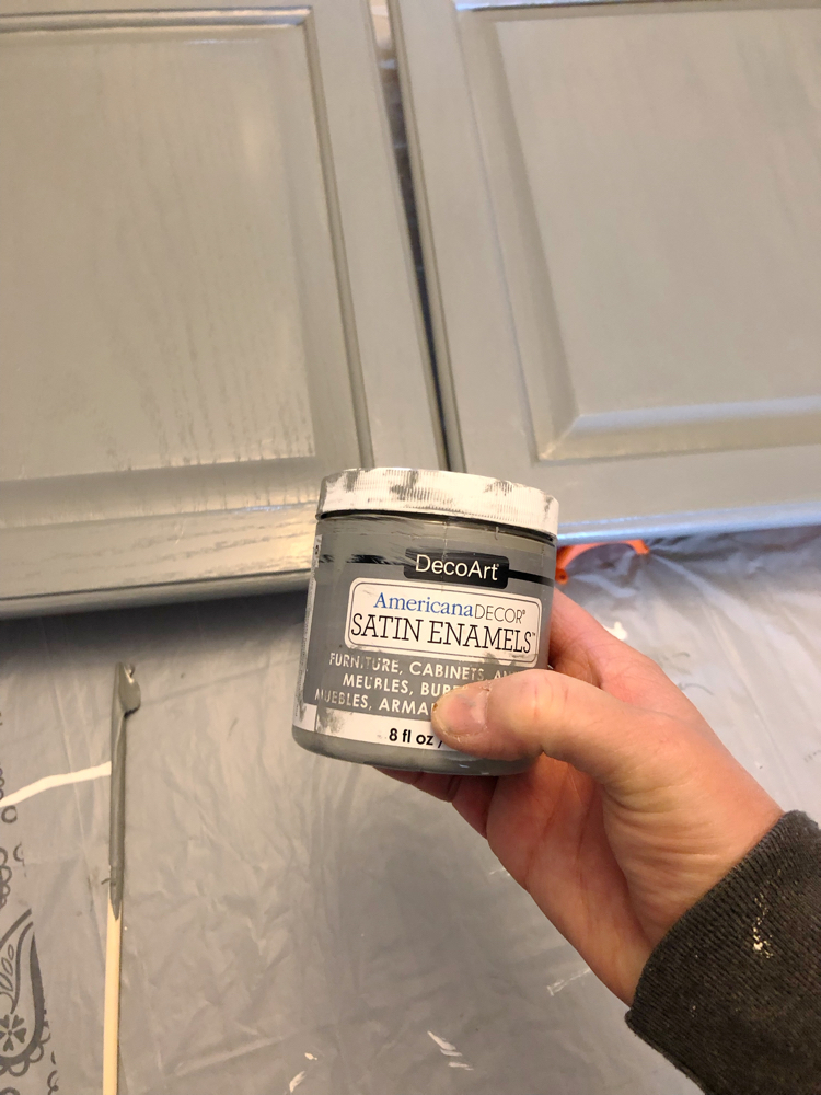 Great tutorial on how to easily give a long-lasting, beautiful finish to an oak cabinet with Americana Decor Satin Enamels Paint