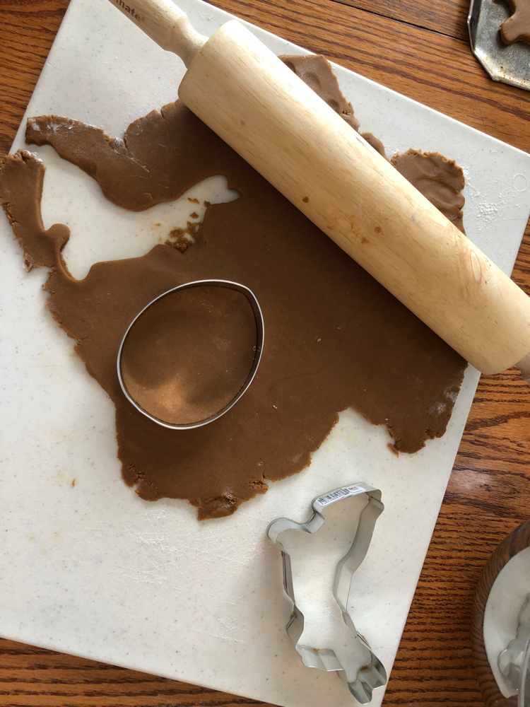 Rolling out gingerbread for Easter cookies